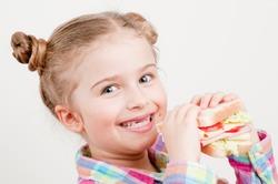 Healthy food - little girl with big sandwich