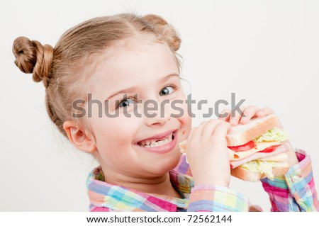 Healthy food - little girl with big sandwich