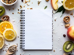 Healthy food nutrition concept, fresh summer fruits nuts granola seeds and empty blank notebook on white background, organic super food on table, detox diet for health care, top view, copy space