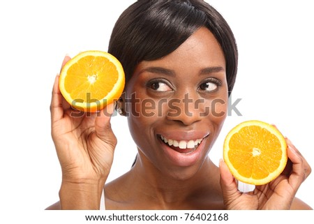 Healthy food promoted with happy smile with orange slice by beautiful young black woman.