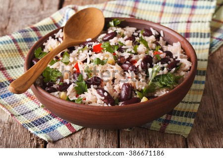 Shutterstock Healthy food: rice with red beans in a bowl close-up on the table. horizontal