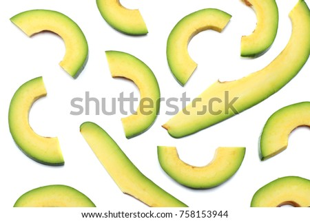 healthy food. sliced avocado isolated on white background. top view
