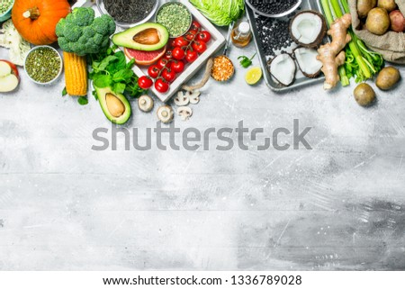 Healthy food. Variety of organic vegetables and fruits . On a rustic background. #1336789028
