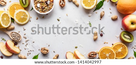Healthy food vegan breakfast nutrition concept, fresh summer fruits granola seeds on white background table, detox diet for health care, top view copy space, horizontal wide banner for website design