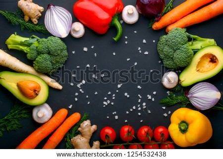 Healthy food. Vegetables and fruits. On a black  background. Top view. Copy space. #1254532438