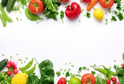 Healthy food vegetarian food background. Frame of fresh vegetables and fruits on white background top view