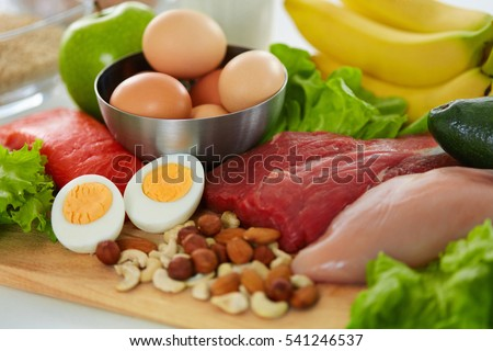 Healthy Foods. Assortment Of Different Food Products On Table. Closeup Of Fresh Organic Vegetables, Variety Of Meats On Kitchen Countertop. Nutrition Concept. High Resolution