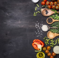 Healthy foods, cooking and vegetarian concept  cherry tomatoes, wild rice, spices, salt border ,place for text  on wooden rustic background top view close up