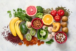 Healthy foods high in potassium. Products containing  vitamins, antioxidants and micronutrients for healthy balanced diet. Top view, flat lay