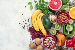 Healthy foods high in potassium. Products containing  vitamins, antioxidants and micronutrients for healthy balanced diet. Top view, flat lay with copy space
