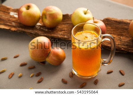 Healthy fresh just squeezed apple juice in glass on the table. #543195064