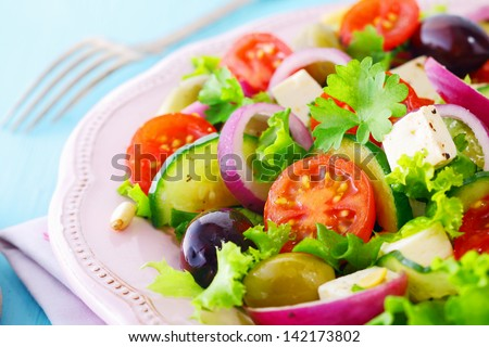 Healthy fresh salad with feta cheese , crispy lettuce, cherry tomato ...