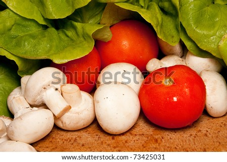 Healthy fresh vegetables: tomatoes, mushrooms, lettuce