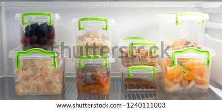 Healthy fresh vegetarian food divided into portions and folded into plastic containers in the refrigerator, the daily diet of a person