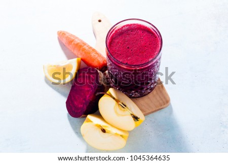 healthy freshly squeezed Juice from Beets, carrots, apples and lemon. detox program, healthy eating, concept of vegans