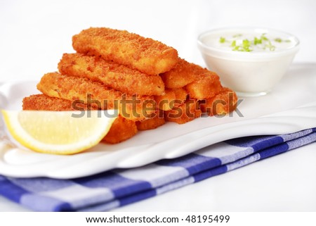 Healthy fried fish sticks with remoulade - stock photo