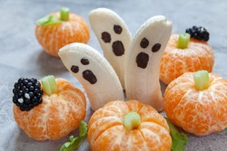 Healthy Fruit Halloween Treats. Banana Ghosts and Clementine Orange Pumpkins
