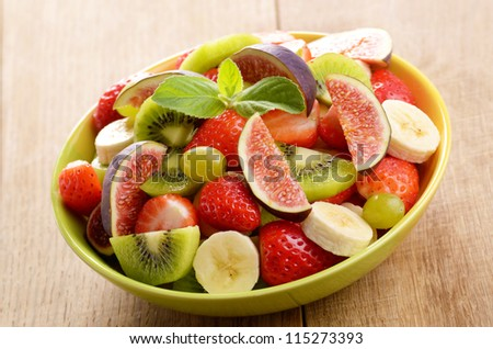 Healthy fruit salad mix on the kitchen table