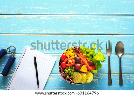 Healthy fruit with vegetable mix salad Healthy, casual lifestyle of Healthy on the vintage blue wood background with copy space, Diet and fitness concept. #691164796