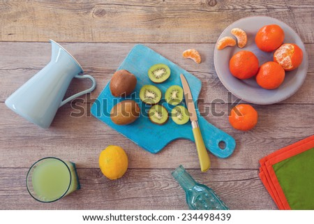 Healthy fruits and juice on wooden table. View from above