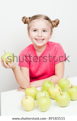 Healthy fruits - cute girl eating green apples