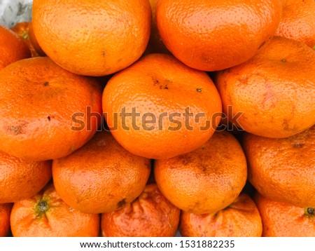 Healthy fruits, orange fruits background many orange fruits - orange fruits background