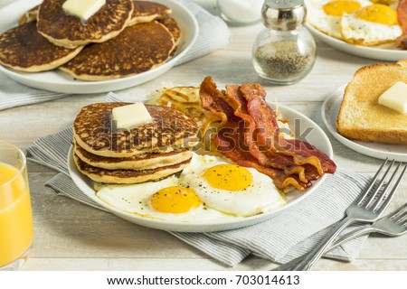 Healthy Full American Breakfast with Eggs Bacon and Pancakes #703014613