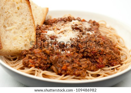 healthy gluten free pasta noodles with home made meat and tomato sauce and fresh toasted garlic bread - stock photo