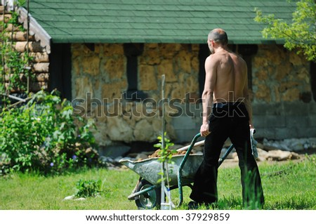 stock photo healthy good looking fit adult man outdoor working in garden 37929859 Katy perry. Slipknot. How I met your Mother. Egypt. Art. Startgate.