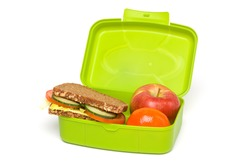 Healthy Green School Lunch Box, Isolated on White, with Whole-grain Bread and Fruit