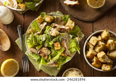 Healthy Grilled Chicken Caesar Salad with Cheese and Croutons #246281896