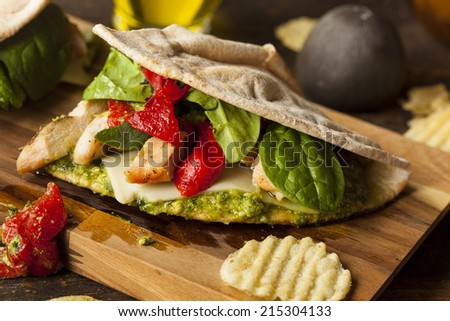 Healthy Grilled Chicken Pesto Flatbread Sandwich with Peppers and Spinach