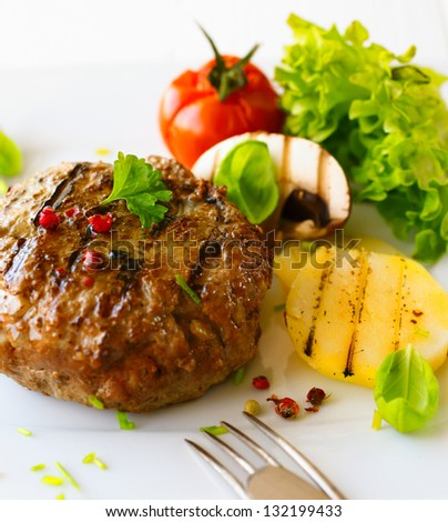 Healthy grilled patty and vegetable in a close up shot