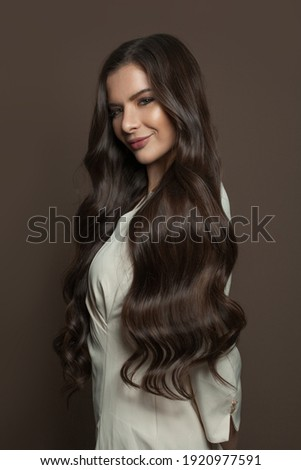Healthy hair woman posing on brown background Stock photo ©