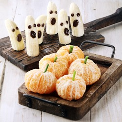 Healthy Halloween Treats Made into Banana Ghosts and Clementine Orange Pumpkins