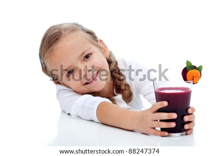 Healthy happy girl with fresh beetroot carrot and apple juice