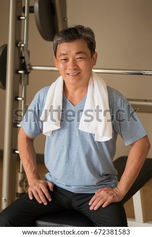 healthy, happy, smiling, positive senior well being asian man working out in gym #672381583