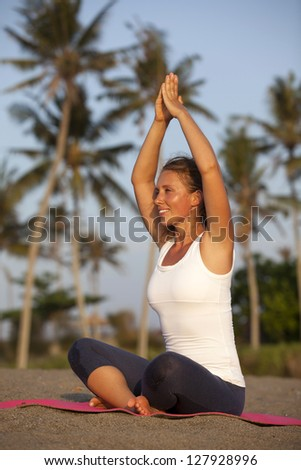 Healthy happy woman doing yoga on mat