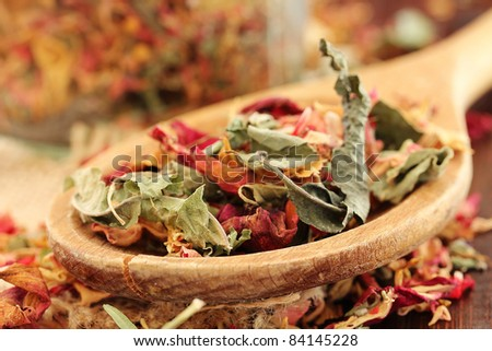 Healthy herbal dry Tea with rose petals (shallow dof)