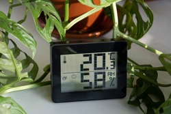 Healthy home. Thermometer and hygrometer. Air humidity measurement. Optimum humidity at home. Thermometer in the interior, among houseplants