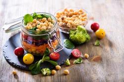 Healthy homemade chickpea and veggies salad in jar, diet, vegetarian, vegan food, vitamin snack