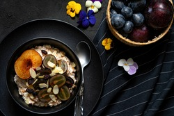 Healthy Homemade Oatmeal with Berries.Top viiew.Dark foodphotography.