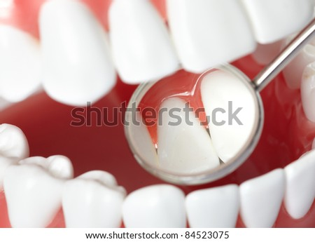 Healthy human teeth and a dentist mouth mirror