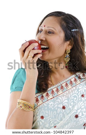 Healthy Indian woman eating red apple, isolated on white background