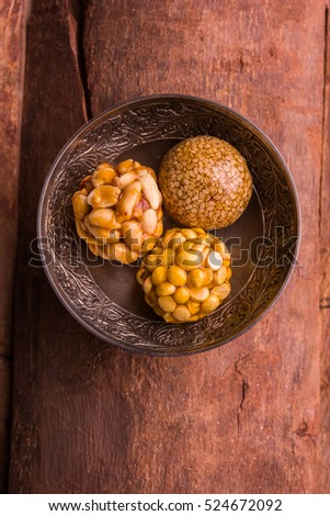 Healthy Laddoo using roasted Peanuts, Sesame and split Daliya with jaggery, served in a bowl, selective focus