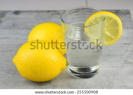 Healthy lemon water on a wooden background