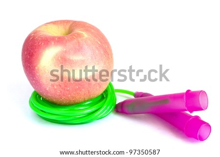 Healthy life concept - apple and jump rope isolated on white background