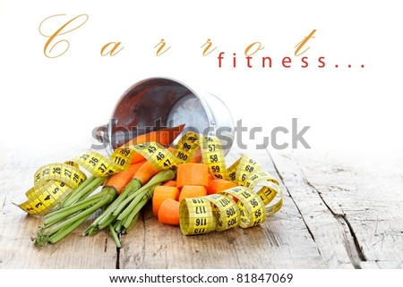 Healthy life concept with carrots and measure tape on rustic table, place for your text