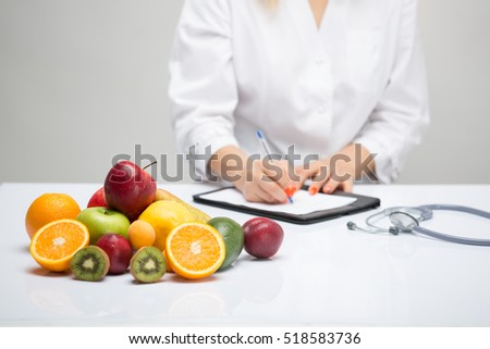 Healthy life style concept, doctor writing, diet and losing weight #518583736