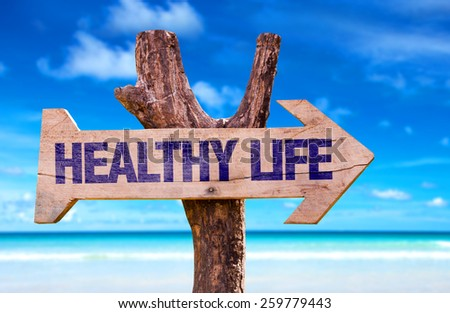 Healthy Life wooden sign with beach background